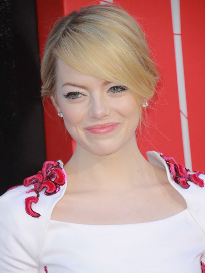 Celeb beauty breakdown: August 2012 cover girl Emma Stone looked fresh and summery at the LA premiere of The Amazing Spider-Man with white eye makeup and glossy pink lips. Learn how to recreate her look here »