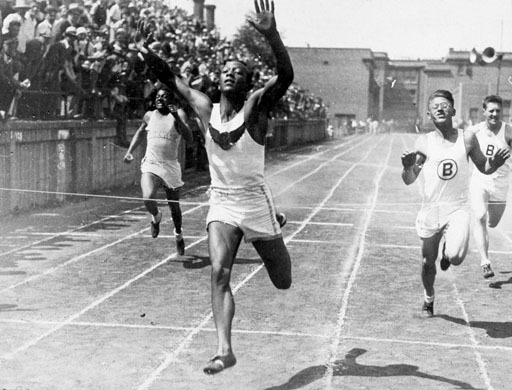 Jesse Owens winning in Berlin. The German Crowds yelling. JESSE OWENS. JESSE OWENS. JESSE OWNES.