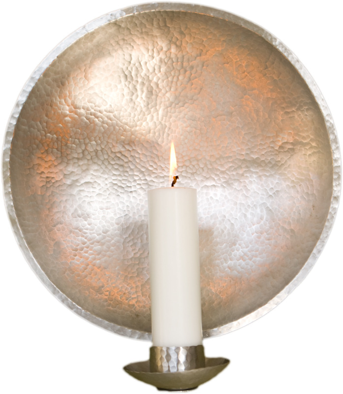 Traditional hammered-metal candle sconces by Malin Appelgren Paulsson.