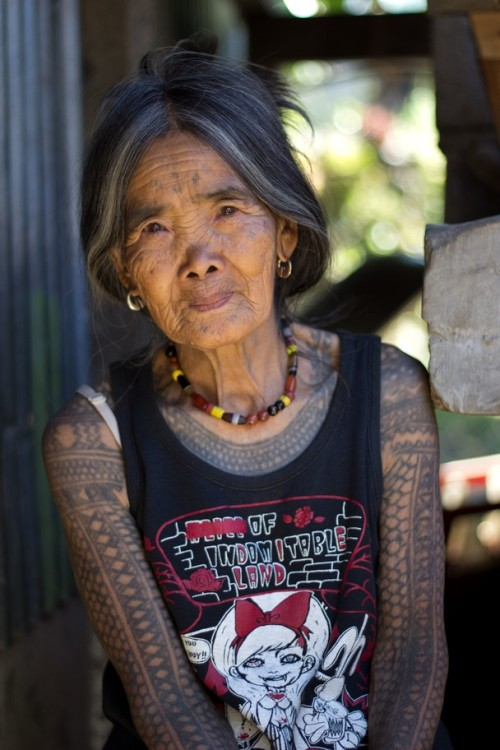 freudian-bitch:  The Last Kalinga Tattoo Artist Photo and caption by Michal Duchek A fascinating culture of the Igorot people brought me and my girlfriend to Kalinga. Head-hunting ceased decades ago, however, the motifs of Kalinga tattoos and the way they are being tattoed remains the same (charcoal and an orange thorn). We decided to visit this beautiful tribeswoman who is the last Kalinga tattoo artist. After a few days, long hours spent on buses and jeepneys, we were lucky to find a local guide Francis who brought us to Buscalan. We were overwhelmed how hospitable and friendly she is. Her natural beauty and her tattoo tempted me to ask her for a pose outside her dwelling. source: nationalgeographic.com  Get ready arms. You gone get pretty.