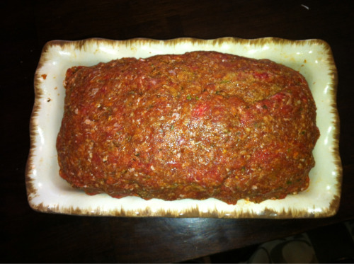 I used a picture of what the meat looked like going into the oven the first time. That's what the consistency of the meat should look like. I love this way of meatloaf it's the only way I'll eat it! It's kind of a mixture between meatballs and lasagna (minus the noodles) its really easy to make! I suggest making it the night before so you can just pop it into the oven! If you do it this way then you don't have to preheat the Ragu.   Italian stuffed meatloaf  1 1/2 pounds of ground beef 2 tablespoons of Basil 1 tablespoon of garlic powder  1 tablespoon of Oregano 1/2-1 cup of Breadcrumbs 1 pound of mozzarella cheese 1 bottle of Ragu  Heat Ragu on stove top  Preheat oven to 350  In a bowl, combine meat and seasonings. I didn't measure the breadcrumbs. Eyeball it. You don't want to much because it'll make it dry, but you want enough to mold your meat. We used at the most 1 cup. add a little bit of Ragu to the meat, just to moisten it a little.   In a loaf pan, layer a thin layer of Ragu. Mold half of meat mixture to the pan. Add 1 1/2 cups of cheese. Mold the rest of the meat into the pan.   Bake for 30 minutes.   The meat should have cooked down a bit. If it already started to make the oil from the ground beef cooking, you can drain some of it out. Pour Ragu over meat and sprinkle with remaining cheese. Bake for an additional 45 minutes.   We used the rest of the Ragu for spaghetti.   Source: family recipe