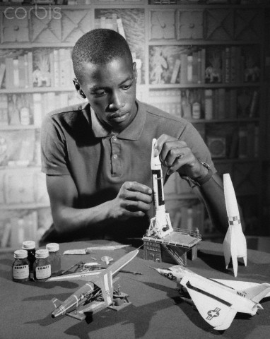 Teenage boy making a model rocket, 1964