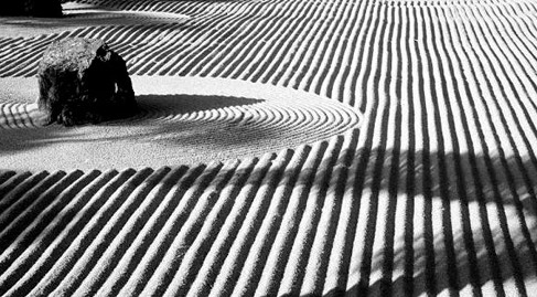 The Zen garden is far more than just a place of beauty, it is an artistic expression or pathway with elements of symbolic meaning to the creator. Many Zen gardens are created to depict various aspects of Asian culture, such as cause and effect, yin and yang.  The Japanese aristocrats who originally designed Zen gardens created them to evoke the same imagery they enjoyed in poetry. This could be a rocky seashore, a field of reeds, or a lonely pine tree.  Priests created their gardens to replicate the landscapes in the Japanese, Chinese and Korean Sansuiga ink paintings. They used white sand, boulders and shrubs to recreate the palette, rhythm and balance of these paintings.  Zen tea gardens were also created for Japan's many tea houses. The garden started from the street and created a path that led to the entrance of the tea house. This was to prepare the individual both physically and spiritually for the act of receiving a bowl of tea.  (via dharmasimulation:)