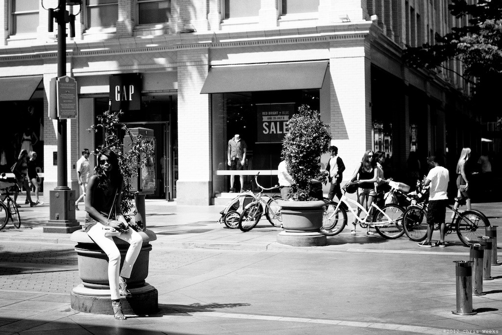 Santa Monica (hell), Calif.:  June, 2012.     Funny when a street scene includes a Victoria's Secret model.  Nikon D800.  1.4G/50.  Aperture » Silver Efex Pro 2.