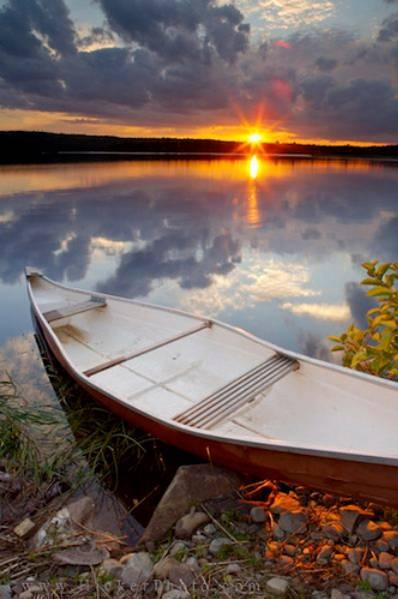 Canoe on a lake at sunset (Nova Scotia, Canada)  by Rolf Hicker Photography