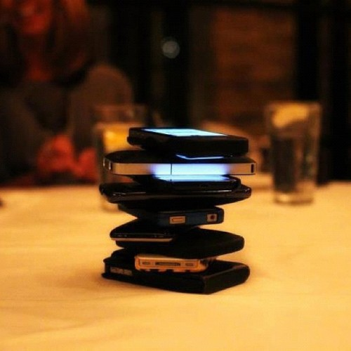"kodakboi:  Everyone puts their phones in the middle of the table. Whoever cracks first by touching their phone, pays for the entire meal. The purpose of the game was to get everyone off their phones, away from twitter, facebook, texting, etc and to encourage conversations. In other words, help cure the ""Anti-Social Social Media Craziness"". Here are the rules: 1. The game starts after everyone sits down. 2. Everybody places their phone in the middle of the table. 3. The first person to touch their phone loses the game. 4. Loser of the game pays the bill for everyone's meal. 5. If the bill comes before anyone has touched their phone, everybody is declared a winner and pays for their own meal. Are You Game? (Taken with Instagram)"