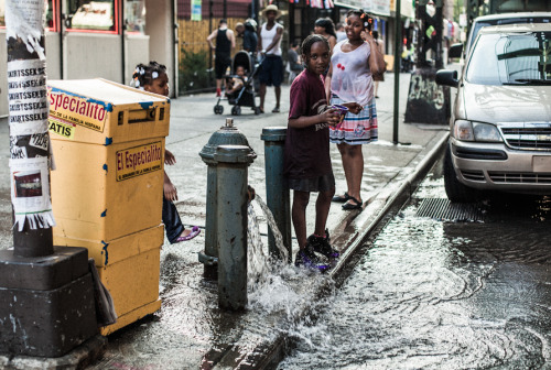 Brooklyn kids enjoy cooling off during record temperatures in the city. Throughout the city, hydrants are unhinged and water released to avoid residents suffering from extreme heat exhaustion. As well as being beneficial to the City's health during the high temperatures, the activities surrounding these hydrants offer the opportunity to see the City at its most care-free and playful.