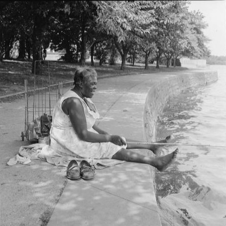 African American woman, seated on ground, fishing, at the Tidal Basin, Washington, D.C. September 1957 Toni Frissell, photographer Library of Congress, Toni Frissell Collection