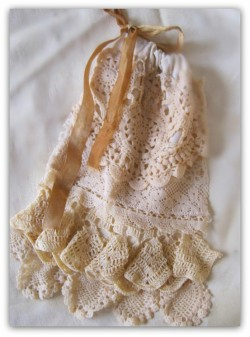 I want to make one of these bags so bad! It actually looks easy. Wowza! You can learn how to here. http://bethleintz.typepad.com/gathering_dust/2011/01/how-to-lacy-ditty-bags-with-vintage-doilies.html