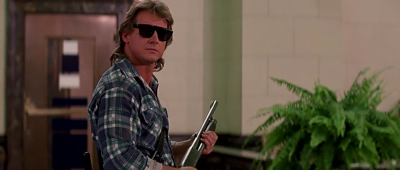 Movie: They Live [1988] Directed By: John Carpenter Movie Poster: They Live Wrestler(s) captured: 'Rowdy' Roddy Piper (as Nada)
