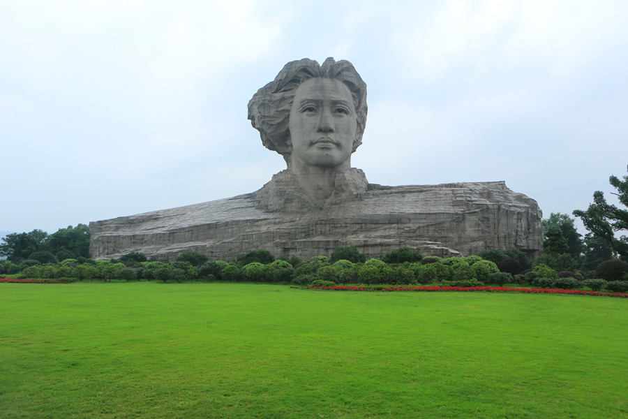A statue of Mao Zedong, former leader of China, stands at the Juzizhou islet in the Xiang River, in Changsha, Hunan Province, China, on June 25. Photograph by Nelson Ching/Bloomberg