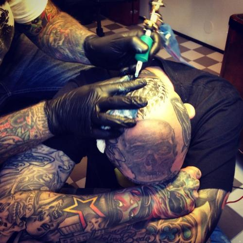 Adrian Edek tattooing