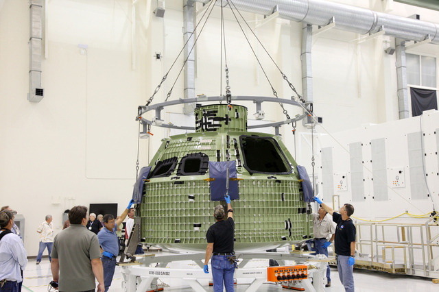 thisistheverge:  NASA reveals Orion capsule, set for eventual Mars mission NASA has unveiled a new passenger module with the ultimate goal of taking astronauts to Mars. Dubbed Orion, the capsule is scheduled to fly its first manned mission in 2021. It arrived at Florida's Kennedy Space Center last Friday, where it will undergo development and testing before an initial, unmanned trial flight in 2014.