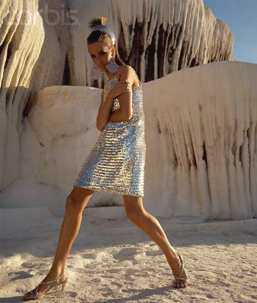 Model wearing a short silver-sequined sleeveless dress by Joan Arkin in Pamukkale, Turkey, 1966. Photo by Henry Clarke.