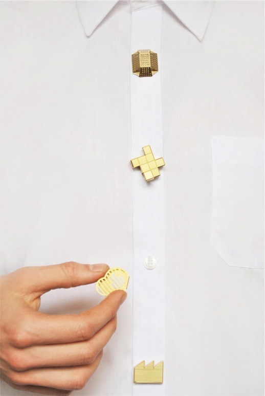 "Button Clips by Studio Swine. ""Studio Swine has created a set of brass buttons to adorn and customise everyday clothing items. The Button Clips simply slide on and off existing buttons without being permanently fixed to one garment. The buttons were made for the 'Once Removed' exhibition at New York Design Week 2012."""