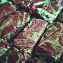 CHOCOLATE MINT BROWNIES Why do I torture myself? Chocolate and mint are one of my favourite flavour combinations. I must be a masochist. These brownies tempted me all the way to the office. Of course I had one. For science. For the blog. Because I have no will power. But I regret nothing. They're really chewy and have lots of mint flavour. (So if you have one for breakfast you won't need to brush your teeth.) Now, before I go into more brownie detail, I must geek out and tell you, this was the first time I used my new electric hand mixer! (Please read that as a high-pitched girlish squeal.) It was an apartment warming gift from Abrubipityboo and it's amazing. You know, some people think that baking gifts have a somewhat dubious motive, and aren't really gifts for me. It's the type of gift giving akin to a man buying his girlfriend lingerie. But I think it's a win-win situation. Buy me pie plates and panties. I dig it. So, I came across the chocolate used in these brownies in a fun and unconventional way. Our agency recently finished a promotion for Philips shaving and grooming products at NXNE, where we gave away free chocolate mustaches to the audience. (Actually, if you saw the Philips tent at NXNE, you might have noticed that photos of the Polish Prince and I were used in the POS. Shameless, isn't it? But we can't help it if we're the office eye candy.) Anyway, a bunch of those mustaches broke during shipping and handling. Hm. What to do about that? Give it to the office baker of course. And now I have 40oz of chocolate in my fridge. So, I've been thinking up tons of ways to transform all this chocolate into different chocolate desserts. Please prepare yourself for a slue of chocolate delights.  BROWNIE LAYER1/2 cup unsalted butter, cut into pieces4 ounces unsweetened chocolate, coarsely chopped1 1/4 cups granulated white sugar1 tsp vanilla extract2 large eggs1/2 cup  all purpose flourPreheat oven to 325ºF and place the rack in the centre of the oven. Prepare a 9 x 9 inch square baking pan with aluminum foil across the bottom and up two opposite sides of the pan. Set aside.In a stainless steel bowl placed over a saucepan of simmering water, melt the butter and chocolate. Remove from heat and stir in the sugar and vanilla extract. Add the eggs, one at a time, beating well with a wooden spoon after each addition. Stir in the flour and salt and beat mix until the batter is smooth and glossy and comes away from the sides of the pan (about one minute). Pour the brownie batter evenly into the prepared pan.Bake in the preheated oven for about 25 minutes or until the brownies start to pull away from the sides of the pan and the edges of the brownies are just beginning to brown. A toothpick inserted in the centre of the brownies will come out almost clean. Remove from oven and place on a wire rack to completely cool.MINT FROSTING LAYER2 tbsp unsalted butter, at room temperature1 cup confectioners sugar1 - 1 ½ tbsp heavy cream½ tsp peppermint extract or 1-2 tbsp creme de menthegreen food colouring (optional)In the bowl of your electric mixer, or with a hand mixer, beat all the ingredients until smooth. Add a few drops of green food colouring if you want the frosting green. If the frosting is too thick, add a little extra cream. (The frosting should be just thin enough to spread.) Spread the frosting evenly over the cooled brownie layer. Place in the refrigerator for about 5-10 minutes or until firm.CHOCOLATE GLAZE LAYER3 ounces semisweet chocolate, chopped1 tbsp unsalted butterIn a heatproof bowl over a saucepan of simmering water, melt the chocolate and butter. Spread over the mint filling and refrigerate for about 30 minutes or until the chocolate glaze starts to dull.Note: I poured the chocolate glaze over the mint layer before it was completely set. This softened the mint layer and they began to mix together. If this happens to you, take a toothpick and make sexy swirls like I did. To Serve: Remove the brownies from the pan by lifting with the ends of the foil and transfer to a cutting board. With a sharp knife, cut into bars. It's a good idea to wipe your knife between cuts with a damp cloth. These brownies can be stored in the refrigerator for several days or else frozen.Yields 32 bars.  Source: Joy of Baking
