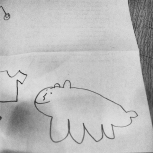 I told my student to draw me a cat. This is what I got. I called it a whale-bear, and he laughed, saying it was adorable.