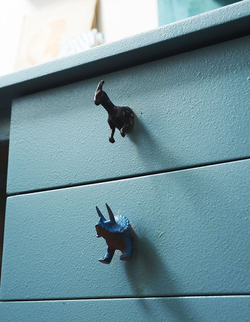 "unconsumption:  DIY idea du jour:  Repurpose kids' toy animals as knobs on drawers or cabinet doors.  For a ""before"" look at this particular desk, click through to Design*Sponge here.  See also: Wooden alphabet blocks and wine corks used as knobs, and pieces of worn leather belts used as drawer pulls. What clever/unusual/quirky things would you do (or have you done) in giving old furniture a makeover?"