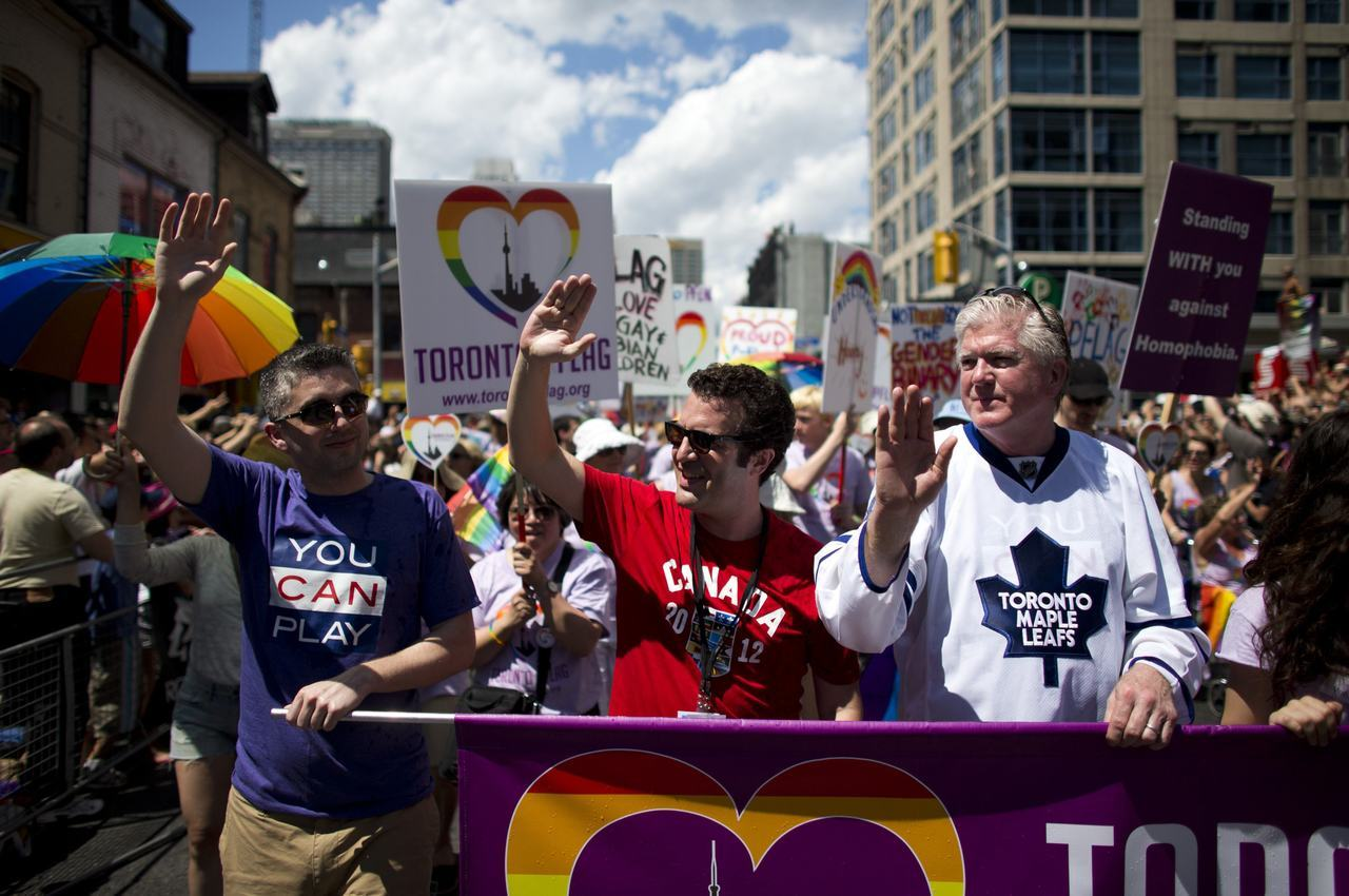Toronto Maple Leafs general manager Brian Burke marches in the city's Pride parade on July 1 with his son Patrick and comedian Rick Mercer. Burke's son Brendan died in a car accident in February 2010. Two months before he died, he told the world he was gay. Burke had promised to march with him in the Pride parade that year, and he kept his promise.  The Post's Bruce Arthur wrote about the first parade Burke marched in to honour his son. This piece was nominated for a National Newspaper Award.