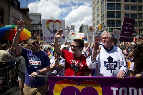 nationalpostsports:  Toronto Maple Leafs general manager Brian Burke marches in the city's Pride parade on July 1 with his son Patrick and comedian Rick Mercer. Burke's son Brendan died in a car accident in February 2010. Two months before he died, he told the world he was gay. Burke had promised to march with him in the Pride parade that year, and he kept his promise. The Post's Bruce Arthur wrote about the first parade Burke marched in to honour his son. This piece was nominated for a National Newspaper Award.  Awesome and heartbreaking at the same time. What a great promise to keep.