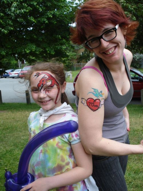 Farmers Market, June 2012. Fake tat by me, Amy Linehan, Dragon by Julia Spry, and balloon sword by Ryan Sullivan. Three of the five main artists for Wandering Brush!
