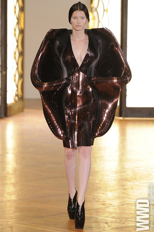 Iris van Herpen Fall Couture 2012 Iris van Herpen's spooky, alien creations looked as though they were about to swallow their wearer whole. For more