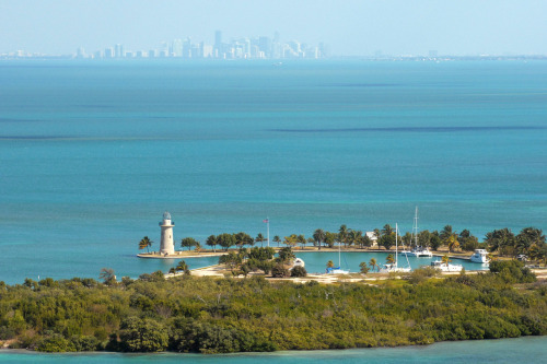 Within sight of downtown Miami, yet worlds away, Biscayne National Park protects a rare combination of aquamarine waters, emerald islands, and fish-bejeweled coral reefs. Here too is evidence of 10,000 years of human history, from pirates and shipwrecks to pineapple farmers and presidents. Outdoors enthusiasts can boat, snorkel, camp, watch wildlife…or simply relax in a rocking chair gazing out over the bay. Photo by National Park Service South Florida / Caribbean Network