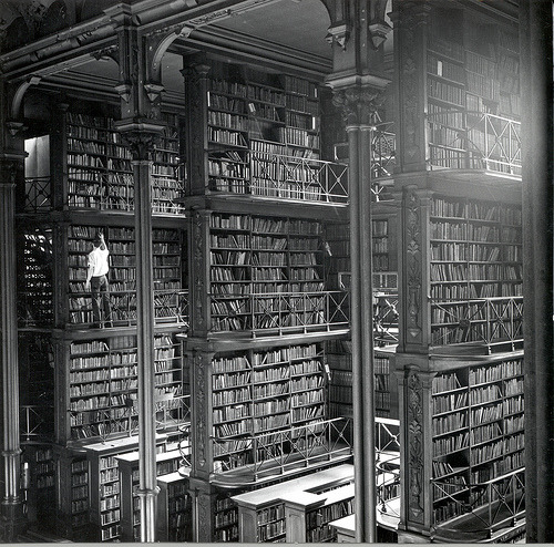 "larmoyante: Cincinnati Public Library, Main Hall, 1874 In 1874 the Public Library of Cincinnati took possession of a small building intended to be an opera house. According to John Fleishman, ""the parcel at 629 Vine Street was transformed in two stages into a library building that startled America with its cutting edge design. Its vast Main Hall featured five tiers of cast-iron book alcoves that could house over 200,000 volumes."""