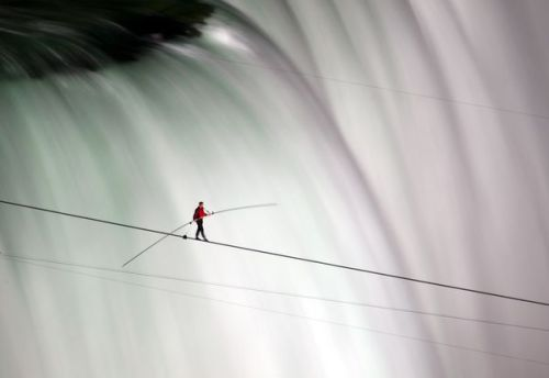 From National Geographic's Best of June Photos. Nik Wallenda walks from Canada to the U.S. on a tight wire above Niagra Falls. Holy crap. Humans are awesome sometimes.