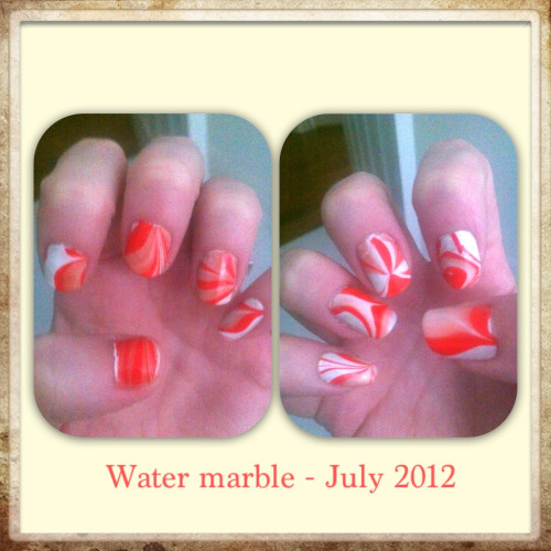 Water marble Base coat: China Glaze- White Out Mable: Revlon- Red Bikini and Revlon- Sheer Seafoam  I was hoping the Sheer Seafoam would come through just a bit more.
