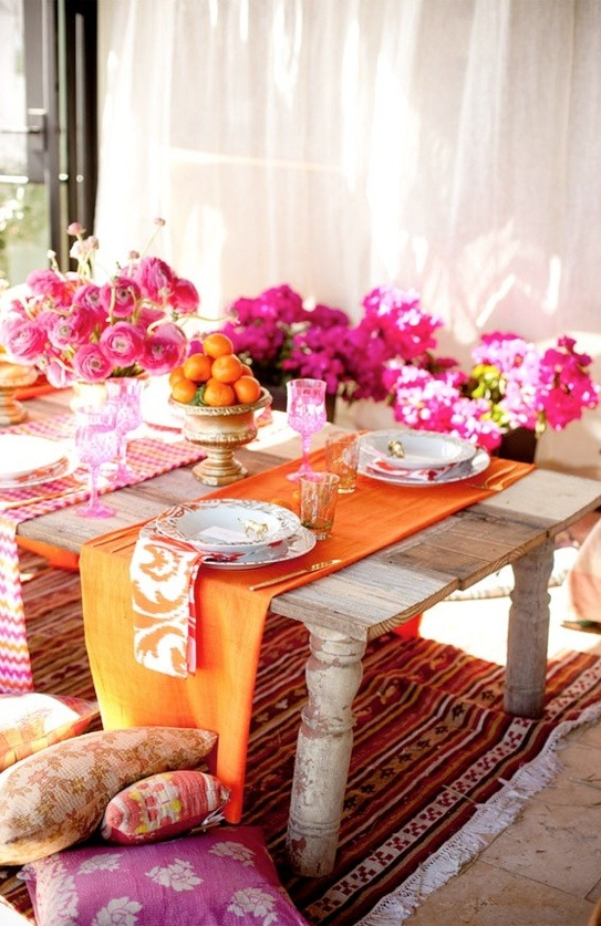 Develop a color scheme for your outdoor party.  It can be based on things you already own, or tie- in to the theme of your celebration.  Coordinating the table setting with florals and fabrics will give your party a cohesive and well planned appearance.