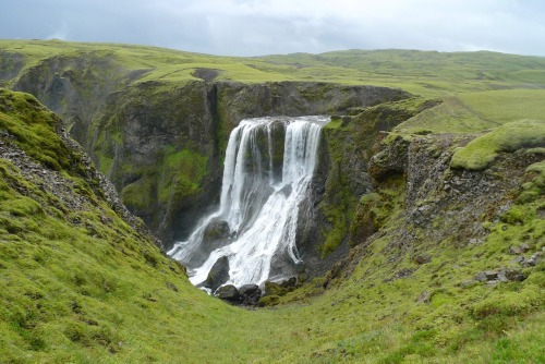 Fagrifoss means Beautiful Waterfall Fagrifoss is a beautiful waterfall in the mossy region around the Laki volcanic fissure that erupted in 1783 killing people around the world. Thanks for the submission Otije.