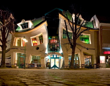 Krzywy Domek, translated as Crooked House, is a shopping center in Sopot, Poland that curves and slants for real! Designed by Szotyńscy & Zaleski, inspired by the fairy tale illustrations of Jan Marcin Szancer and Per Dahlberg