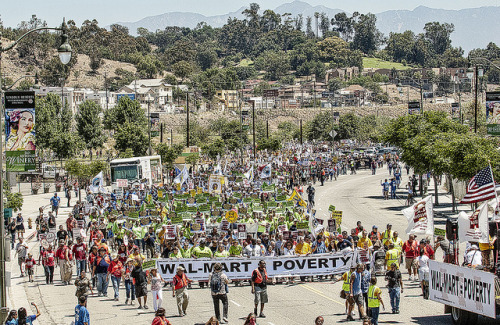 "Thousands March Against Walmart in Los Angeles on Flickr. Wal-Mart = Poverty In the largest-ever protest against Walmart in U.S. history, thousands in Los Angeles demanded the world's largest private employer start respecting its workers and communities or stay out of L.A. Union workers from across the L.A. labor movement marched alongside Walmart and warehouse workers, Chinatown residents, community and civil rights groups, faith leaders, and our sisters and brothers from the San Diego, Orange, South Bay and San Francisco labor councils who came on buses to stand up to Walmart and stop the ""Walmartization"" of L.A. jobs. The Teamsters trucks and Horsemen motorcycle club kicked-off the march from the Los Angeles State Historic Park through the streets of Chinatown. Carrying a massive banner that read: ""Walmart = Poverty,"" Walmart workers and Chinatown residents led the march of thousands holding signs: ""Walmart: How the 1% Hurts the 99%."" Under the iconic Chinese dragons in Chinatown, L.A. Labor's Maria Elena Durazo opened the rally. ""Walmart's chief product is poverty.  Walmart gets rich by keeping its employees poor; however, Walmart workers are organizing for decent wages and affordable benefits. They have the right to dignity and respect and Walmart can afford to do better.  Until Walmart stops selling poverty, we don't want it in Los Angeles,"" said Durazo. Walmart and warehouse workers filled the stage. ""I work hard at Walmart's Crenshaw store, but even with a promotion, I still have to rely on public healthcare for my kids,"" said Girshriela Green, a Walmart associate and member of OUR Walmart, a growing organization of Walmart associates nationwide. ""Working hard should mean getting ahead – but it doesn't at Walmart.  If we don't put an end to the Walmart model of making a few people rich and keeping the rest of us struggling, we are going to live in a country with no middle class at all.  For my kids and for my community, I'm speaking out for change at Walmart."" Grammy winners, singer-songwriters and members of Professional Musicians Local 47 Tom Morello and Ben Harper gave energizing live performances. Speakers included co-founder of the United Farm Workers and 2012 recipient of the Presidential Medal of Freedom Dolores Huerta, U.S. Congresswoman Judy Chu, United Food and Commercial Workers President Joe Hansen, UNITE HERE President John Wilhelm and more! To read the full story, click here. To see the photos on Facebook, click here."