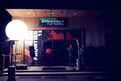 "As Sundance becomes progressively more established as a global film market, fest programmers have to work diligently to preserve its artistic integrity. Hence the unveiling of an expanded New Frontier section this year, featuring moving image installations from 11 visual artists. …. [Shari] Frilot promises the New Frontier on Main will be ""as much a social space as an art space,"" with an adjunct lounge boasting DJs and a chance for face time with the artists themselves. Much of the installation art has a social aspect as well. Lincoln Schatz's ""Cluster"" is a sort of mutating mirror that records its observers, then blends that footage into an evolving collage with other images recorded previously. Shu Lea Cheang's ""MobiOpera"" invites the hoi polloi to contribute cell phone-helmed segments to form a composite soap-opera. And the aptly titled ""Lunch Film,"" commissioned by Mike Plante, treats 14 filmmakers to lunch in return for a short film made with an equivalent amount of money. ""It was a goal to include new media,"" Frilot explains. ""The whole scene is changing now, where distribution is becoming part of the narrative — of the filmmaking — where you're there looking at something and you actually become part of the story."" While all of the installations utilize film or video, some are particularly inspired by cinematic history. ""Copenhagen Cycles,"" from Eric Dryer, uses a series of zoetropes to create a mobile portrait of the Danish capital. R. Luke Dubois exploits Sundance's industry connection even further in his piece ""Academy,"" which compresses each best picture Oscar winning film into a single minute and runs them consecutively. According to director of programming John Cooper, compatibility with the festival was a concern when soliciting artists. ""I like the fact that we're providing a platform in the film world, instead of the museum art world,"" he says. ""So we did look for artists that seemed right for that context."" But will the amassed acquisitions execs, busy scouring screenings for the next ""Little Miss Sunshine,"" take time out to nurture their artistic side? ""Ah, we don't care,"" laughs Cooper, adding: ""We have a launch party for it on the opening night of the festival, even before the opening-night film. So we're certainly committed to making sure people know it's there."" But beyond aggressively promoting it, the 17-year festival veteran is content to give the show room to grow. ""We're letting it sort of build on its own, which is how we did everything early on at Sundance,"" Cooper notes. ""We don't decide where to take things, or what will be the next movement. You just follow what the artists are doing, and they'll take you there. So it's so much more organic, and kind of no-fail."" Excerpted from Variety Magazine, ""Sundance's New Frontier preserves artistic integrity,"" January 17, 2007 Photo Credit: http://littleveganplanet.tumblr.com/post/17758423135/sundance2012"