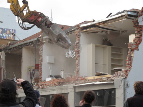 thednzfanclub:  Chandelier rescue After the September 2010 Christchurch earthquake, I got to see some interesting things on the way to work. One of the most surreal was a crane rescuing a chandelier as a building was demolished. It was placed with utmost delicacy into the hands of its owner, to cheers from the crowd.Demolition of Robertsons Bakery September 8 2010 130, Kete Christchurch