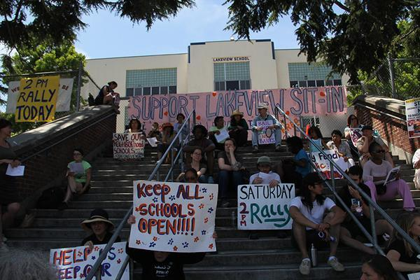 Oakland: Lakeview Elementary Occupation Raided; Rally at 2PM Since June 15, parents, teachers, students, and allies from Oakland have occupied Lakeview school in response to the closure of five public elementary schools. Officials want to convert the buildings into private charter schools and offices, forcing students into different schools ten miles away without offering transportation. On the last day of class, community members began an on-going sit-in. They set up a community space complete with a library, free classes for children, social justice training, and more. Members of Occupy Oakland and other local Occupations have offered support and security patrols for the brave community members inside. Around 25 people were inside this morning when Oakland police issued an evacuation order at 4 a.m. while most of the city and potential supporters slept. Just before 6 a.m., police raided the site and issued a dispersal order. Most of those inside complied with the order voluntarily, while a few remained inside in nonviolent protest. A parent and a former Lakeview student were arrested. According to witnesses, police threatened to use chemical weapons despite the presence of children and would not allow legal observers or media inside. Also according to witnesses, sanitation crews rushed in and the city immediately began building a fence after the arrests were made. The community has vowed to stay and not give up the struggle to defend public education. A convergence of occupiers and all supporters has been called for 5pm Pacific today in front of Lakeview.