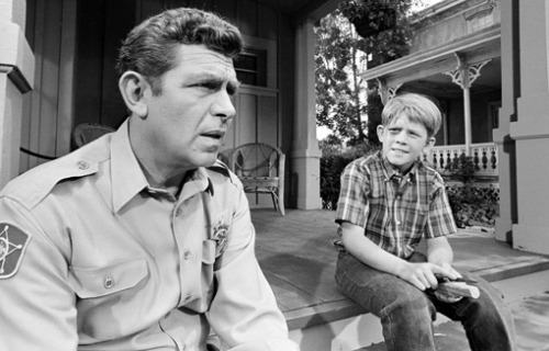 "Ron Howard remembers Andy Griffith's 'great sense of humor about life' Television icon Andy Griffith, best known as the sage town sheriff in the '60s sitcom The Andy Griffith Show and as a cantankerous defense attorney on 1980s-'90s drama Matlock, died today in Roanoke Island, N.C. He was 86 years old. Friend and former University of North Carolina president Bill Friday confirmed the news to WITN News, an NBC affiliate in Washington, N.C. We asked Ron Howard, who played Andy Griffith's son Opie on The Andy Griffith Show, about his favorite memories about his TV Dad.  ""There was a fantastic equilibrium between his love of laughter and jokes and funny stories and songs and all that, and then he could turn on a dime and be the utmost professional….If people who met him were to be surprised [to learn something about him] it would be this sort of simple commitment to excellence. This straightforward work ethic that he adhered to in a very unpretentious way with great humility and very few words.""  —Ron Howard shares memories of Andy Griffith"