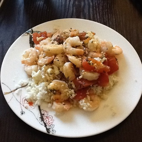 Roasted tomatoes, shrimp and feta cheese over rice. Thanks, Amy and Pinterest.