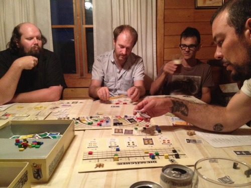 It is the ninth-and-a-half hour of Die Macher, which is said to be a fun game (albeit a highly, exquisitely, painfully Euro one). We did not play Die Macher. We swam instead. And then we snacked, because we are waiting for tonight's dinner cook to cook dinner, but tonight's dinner cook is playing Die Macher. It is 9:30 and there is no dinner. We considered driving into town, to the only restaurant, for a drink and a burger, but we are already a little drunk so we can't. So our game is waiting for dinner. We are three and a half hours in.