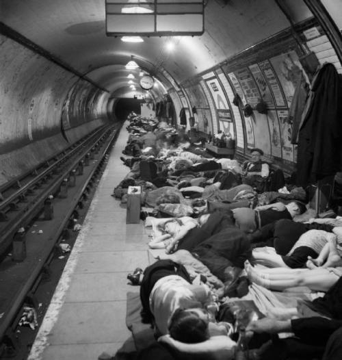 "lostsplendor:   ""Elephant and Castle London Underground Station Shelter: People sleeping on the crowded platform of Elephant and Castle tube station while taking shelter from German air raids during the London Blitz."" November, 1940  (via Imperial War Museums)"