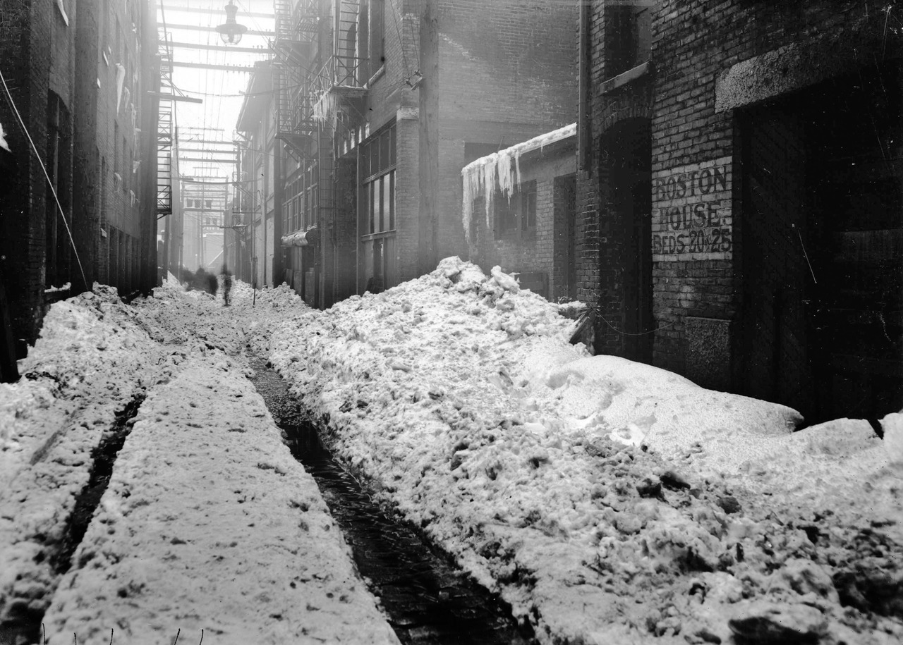 Boston House, Wednesday 9 February 1916 Alley west of Carrall and north of Hastings. The sign for Boston House was already a ghost sign in 1916. It's long gone now, but at the end of the alley, another sign for Boston House is still there and is one of the oldest ghost signs in town, if not the oldest. Boston House was a rooming house run by Mary Logan in 1899 for milliners (ladies hat makers) like herself. Source: City of Vancouver Archives #789-82