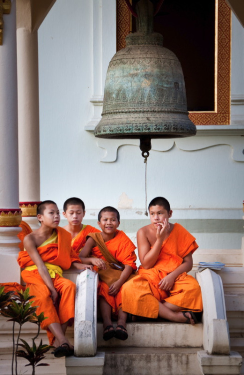 "Young ""nain"" novice monks chatting together in Wat Phra Singh temple in Chiang Mai, Thailand."