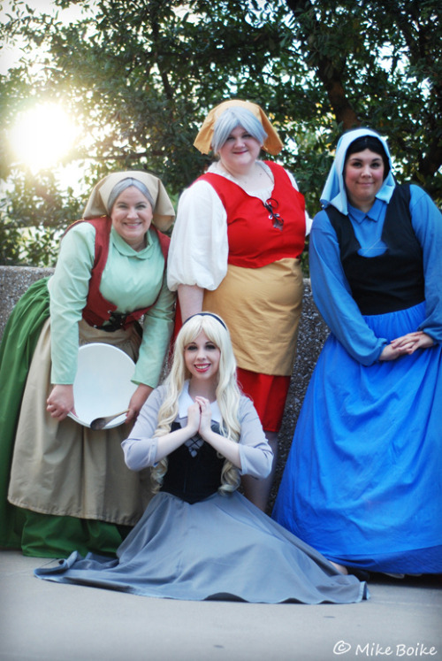 "Briar Rose/ Aurora, Flora, Fauna, and Merryweather from Disney's Sleeping Beauty. There's that scene where the two fairies are fighting over the color of the dress: ""Make it blue!"" ""Make it pink!"" And every time I see that scene, I hear: ""Blue no yeeeeeeellooooooooow"" Cosplayers: uncredited (let us know if you know them) Photographer: Mike Boike"