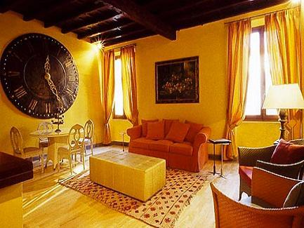 enjoys a wonderful location in Rome's city center, only 200 meters away from the Trajan's Market and less than 15 minutes from both the Colosseum and the Domus Aurea. On the upper floor of a noble palace dating back to the XVIII century with the archaeological district on its doorstep, it is within walking distance of the Quirinal Palace, now the official residence of the Italian President, Santa Maria in Aracoeli Church and the Imperial Forum, surrounded by the ruins of columns and what used to be government buildings in ancient Rome. http://www.rentxpress.com/property/serpenti-penthouse