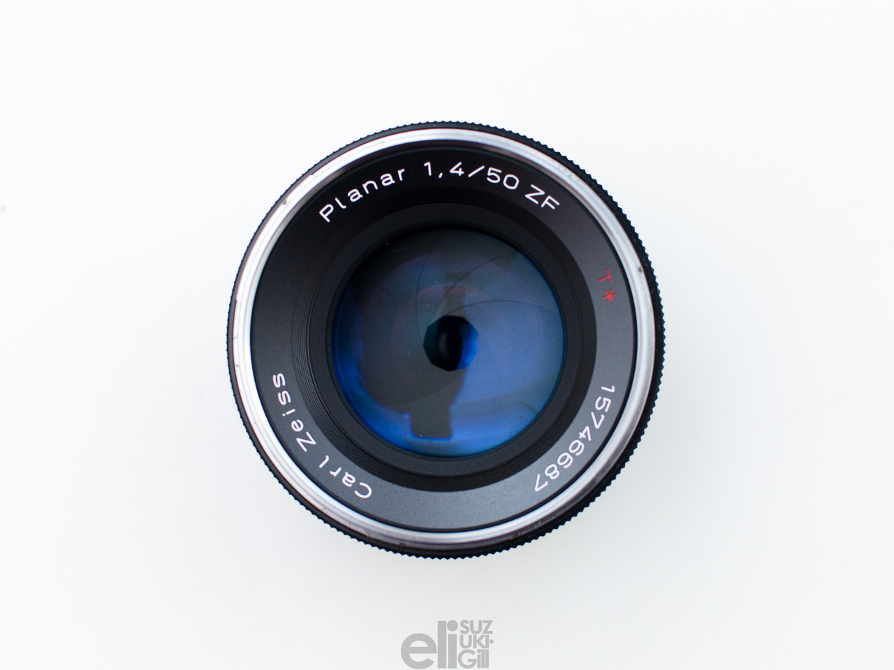 "It's always bittersweet selling lenses like this… The purchase of this lens marked the beginning of my dedication to re-learning the process of shooting and developing 35mm film. Since then, I've moved to an autofocus body so that I can use Nikon's newer 50mm 1.4G. That doesn't sound as cool as ""Zeiss Planar T* 50mm 1,4 ZF"", but I just couldn't get used to the loss of wide-open sharpness on this lens. I need that wide-open sharpness much more often than I need the 270˚ focusing ring rotation, and I can create a soft, dreamy image using other methods. Seriously though, this lens was awesome in a lot of ways. Also, Happy 4th of July, America."