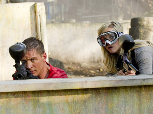 "A still from This Means War - I love paintballing Tom, he's awesome. *g* In an interview, Reese described Tom this intriguing way (shrewd - ha!):  ""Tom's English, covered in tattoos and is very strong, shrewd and very aware of the room."""