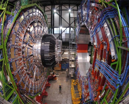"discoverynews:  Particle 'Consistent' With Higgs Boson Discovered The Higgs boson mediates the ""Higgs field"" that ultimately endows all matter with mass — finding the Higgs is therefore imperative for physicists to understand what gives the Universe substance. In other words, this discovery could lead to a whole new understanding of how the universe began. When reports first surfaced that Peter Higgs — one of the six physicists who, in the 1960s, developed the theory behind Higgs boson — had been invited to CERN for this morning's announcement, the event became hard to ignore: something historic was about to happen. keep reading A helpful piece on how stuff works on ""What exactly is the Higgs boson?"""