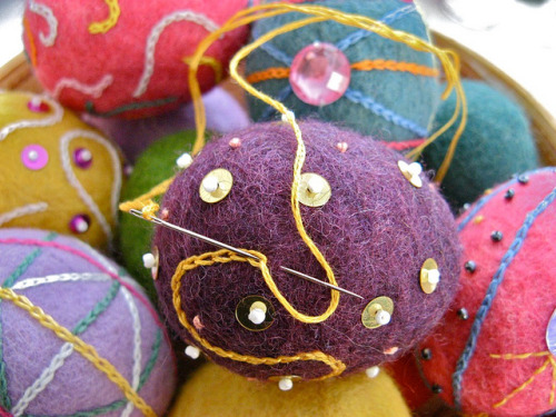 Embroidering felted eggs by Liiolii on Flickr.