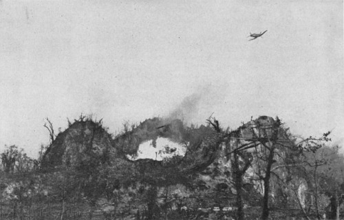 An F4U Corsair aircraft attacks a japanese bunker it the Umurbrogol mountains with napalm bombs. Peleliu campaign, 1944.